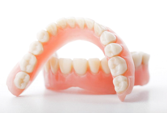 Протез с настоящими зубами